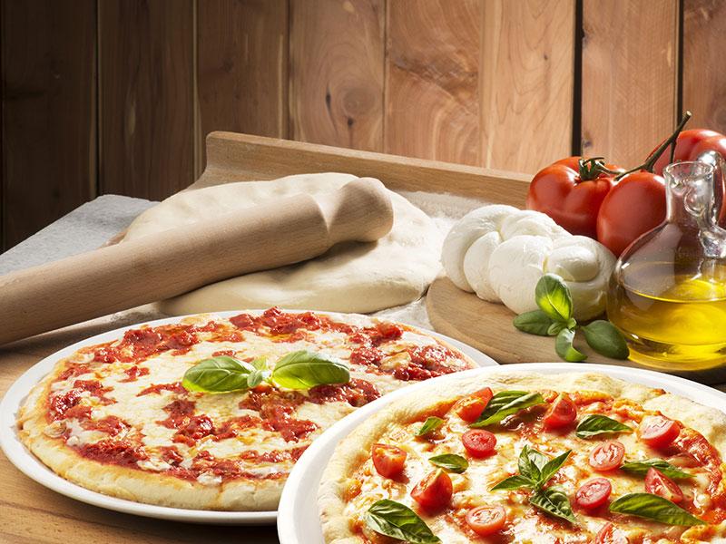 Abbildung von 2 Pizzen